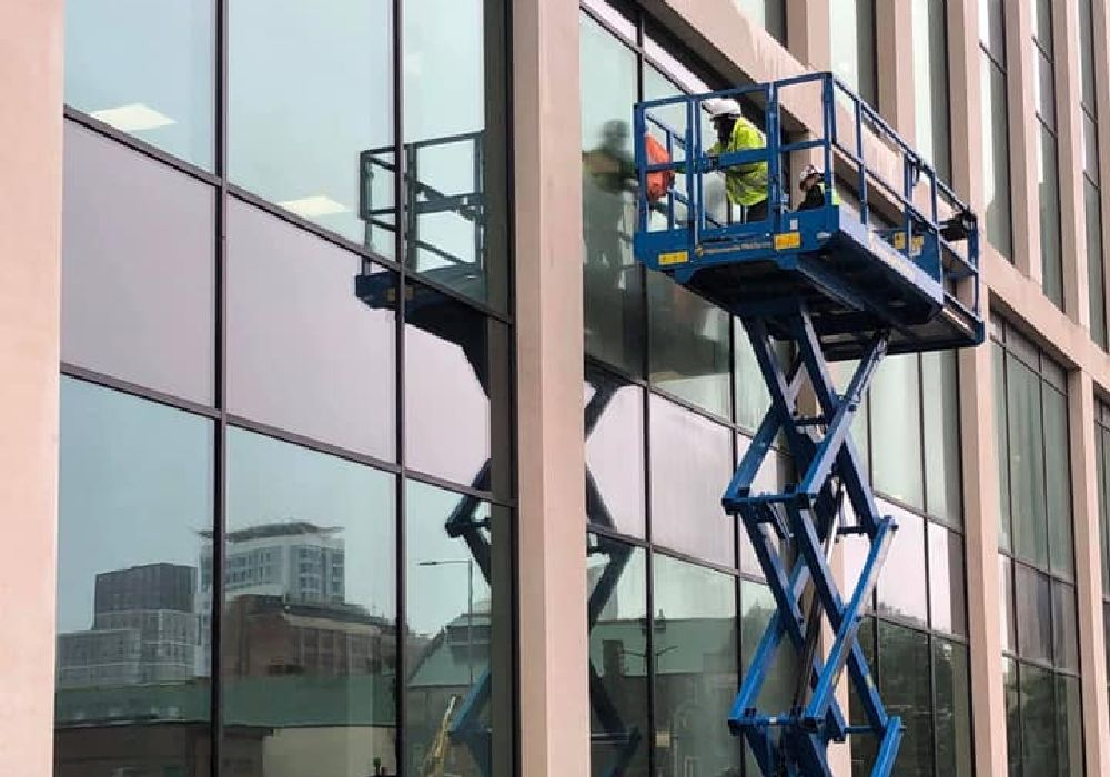 People Cleaning Office Building Windows