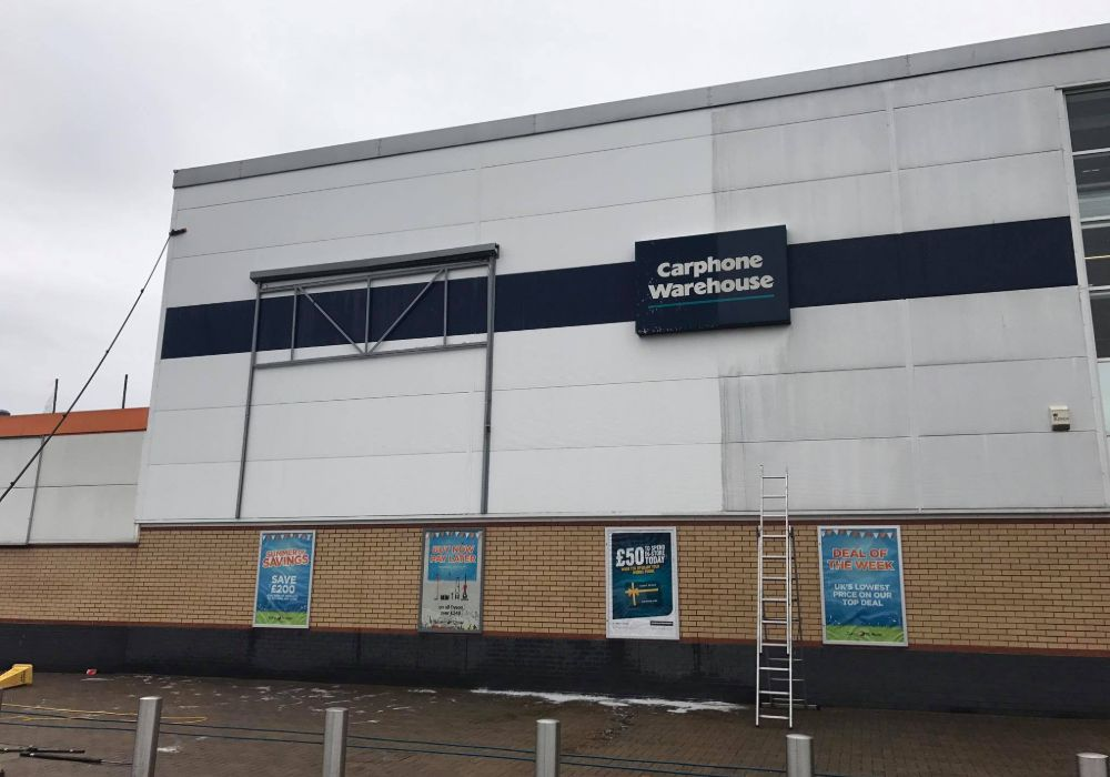 Team Cleaning Exterior Of Carphone Warehouse Building