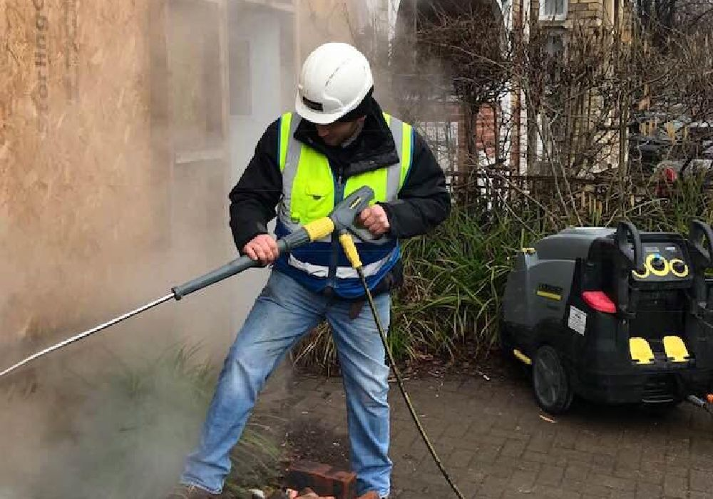 Person Using Pressure Washing Machine