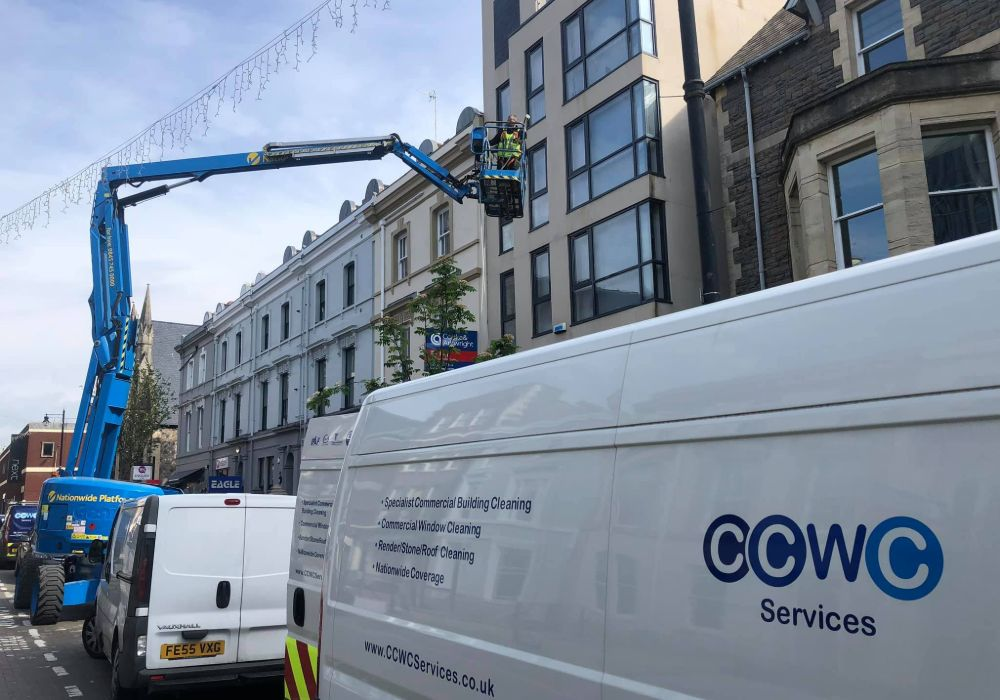 Person Cleaning Building Windows In Swansea Wales